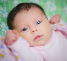 Beautiful Baby Girl Is Lying In A Bed. Royalty Free Stock Images