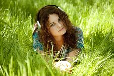 Redhead Girl With Headphone At Green Grass Royalty Free Stock Photography