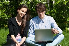 Free Couple Sitting In Park And Using Laptop Stock Image - 19519641