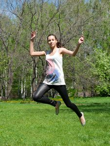 Free Happy Young Woman Jumping In Air Royalty Free Stock Image - 19519646