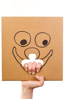 Free Cardboard With Sketch Of Smiling Face In Hand Royalty Free Stock Photos - 19522308