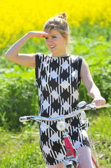 Young Girl With A Vintage Bicycle Stock Images