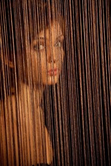 Free Woman Looking Through Threads Stock Photography - 19523742