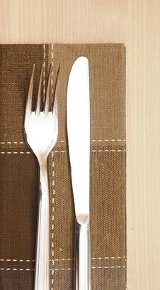 Knife And Fork With Napkin Stock Images