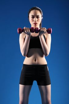 Fit Young Oriental Woman Lifting Exercise Weights Stock Images