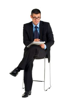 Free Sitting Businessman With Eyeglasses Writing Royalty Free Stock Photography - 19525357