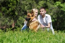 Free Couple With Dog Outdoors Stock Photography - 19525432