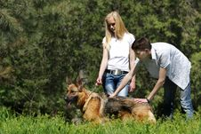 Free Couple With Dog Outdoors Royalty Free Stock Photography - 19525467