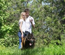 Couple With Dog Outdoors Royalty Free Stock Photo