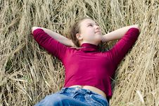Free Girl Lays On A Dry Grass Royalty Free Stock Photo - 19527405