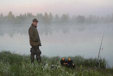 Fisherman On A Morning Foggy Lake Royalty Free Stock Photos
