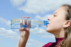 Free Girl Drinks Water Against The Sky Royalty Free Stock Images - 19527409