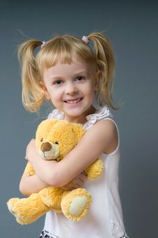A Girl And A Toy Stock Images