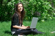 Free Young Woman Sitting In Park And Using Laptop Stock Photos - 19528753