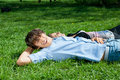 Free Young Couple Lying On The Grass In Park Royalty Free Stock Photos - 19539818