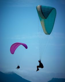 Free Paragliders Soaring In A Blue Sky Stock Photography - 19530562