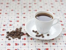 Free Cup Of Coffee And Coffee Beans Stock Images - 19535234