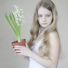 Free Young Girl Holding A Pot Of Flowers Stock Photo - 19535450