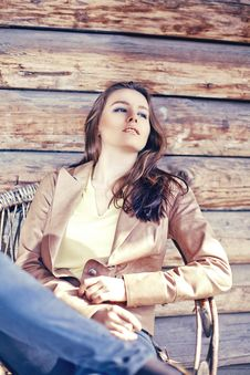 Young Beautiful Brunette Woman Sit In Arm Chair Stock Photography