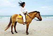 Free Young Woman Riding A Horse Royalty Free Stock Photography - 19536317