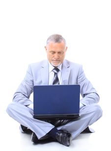 Executive Sitting On The Floor Cross Stock Photography