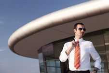 Free Cool Businessman In Front Of Office Building. Stock Image - 19537451