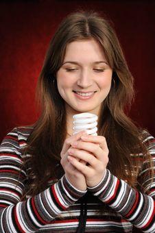 Free Woman Holding An Fluorescent Light Bulb Stock Photos - 19538633