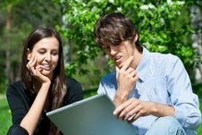 Free Couple Sitting In Park And Using Laptop Stock Images - 19539794