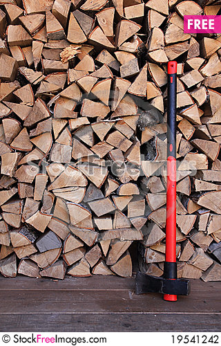 Axe with firewood background Stock Photo