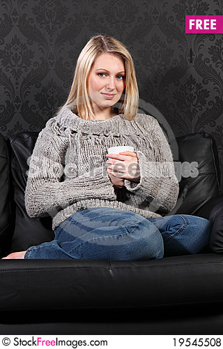 Happy young woman feet up enjoying coffee drink Stock Photo