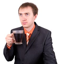 The Young Businessman Drinks Coffee. Royalty Free Stock Image
