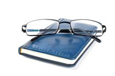 Free Blue Notebook And Glasses Royalty Free Stock Image - 19540786