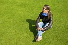 Free Girl Sitting On A Green Lawn Royalty Free Stock Photography - 19543647