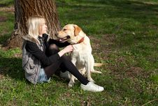 Beautiful Woman With Dog In The Park Stock Photography