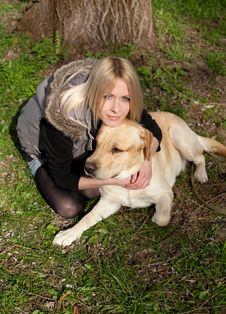 Beautiful Woman With Dog In The Park Royalty Free Stock Photography