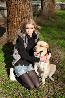 Beautiful Woman With Dog In The Park Royalty Free Stock Image