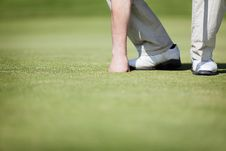 Free Golfer Picking Up Ball. Stock Photos - 19548983