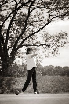 Golf Player Teeing Off. Royalty Free Stock Photo