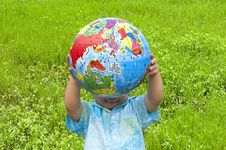 Boy Holding The Earth Model Royalty Free Stock Photography