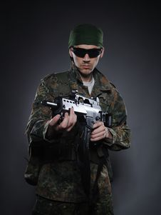 Young Soldier In Camouflage With A Gun Royalty Free Stock Photography