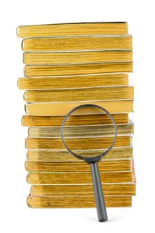 Free A Stack Of Books And Magnifying Glass Royalty Free Stock Photography - 19551467