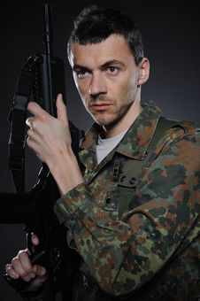 Young Soldier In Camouflage With A Gun Royalty Free Stock Image