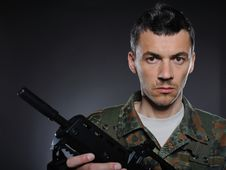 Free Young Soldier In Camouflage With A Gun Stock Photography - 19551582