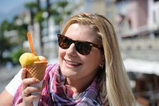 Free Pretty Summer Girl Eating Ice Cream Outdoors Stock Photography - 19551802