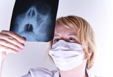 Free Female Doctor Looking At A X-ray Stock Photography - 19553522