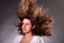 Free Young Brunette Woman With Long Flying Hair Stock Images - 19554194