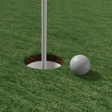 Free Golfball Close Up To Pin On Green Stock Photography - 19555812