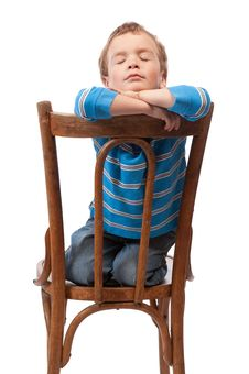 Free Little Boy Sits In  Chair With His Eyes Closed Stock Photos - 19559243