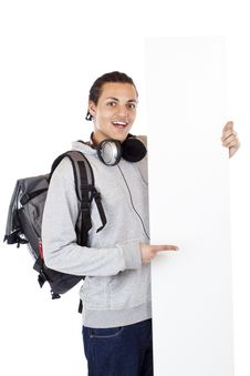 Free Dark-skinned Happy Young Man Points To Ad Space Stock Photography - 19560102