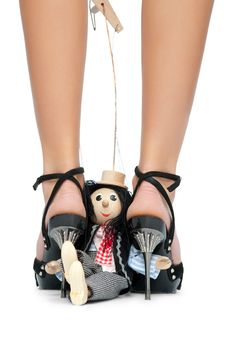 Free Toy Puppet Sits Near The Feet Of A Woman Stock Photos - 19561263